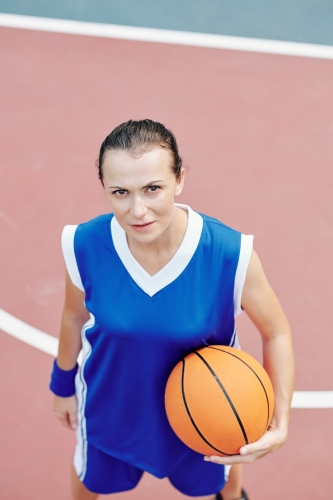 Sportswoman with basketball ball